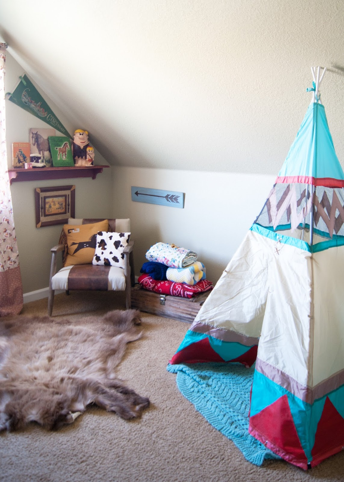 A western bedroom - tent, mid century chair, heirlooms and flea market finds