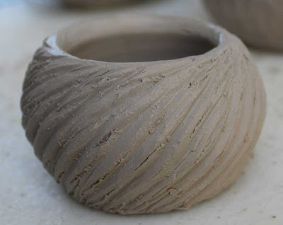 carved pottery bowl unfired