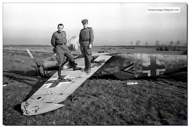 Russian officers pose  wreck  German Messerschmitt fighter. 1944.