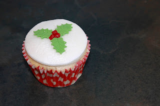 Holly topped cupcake