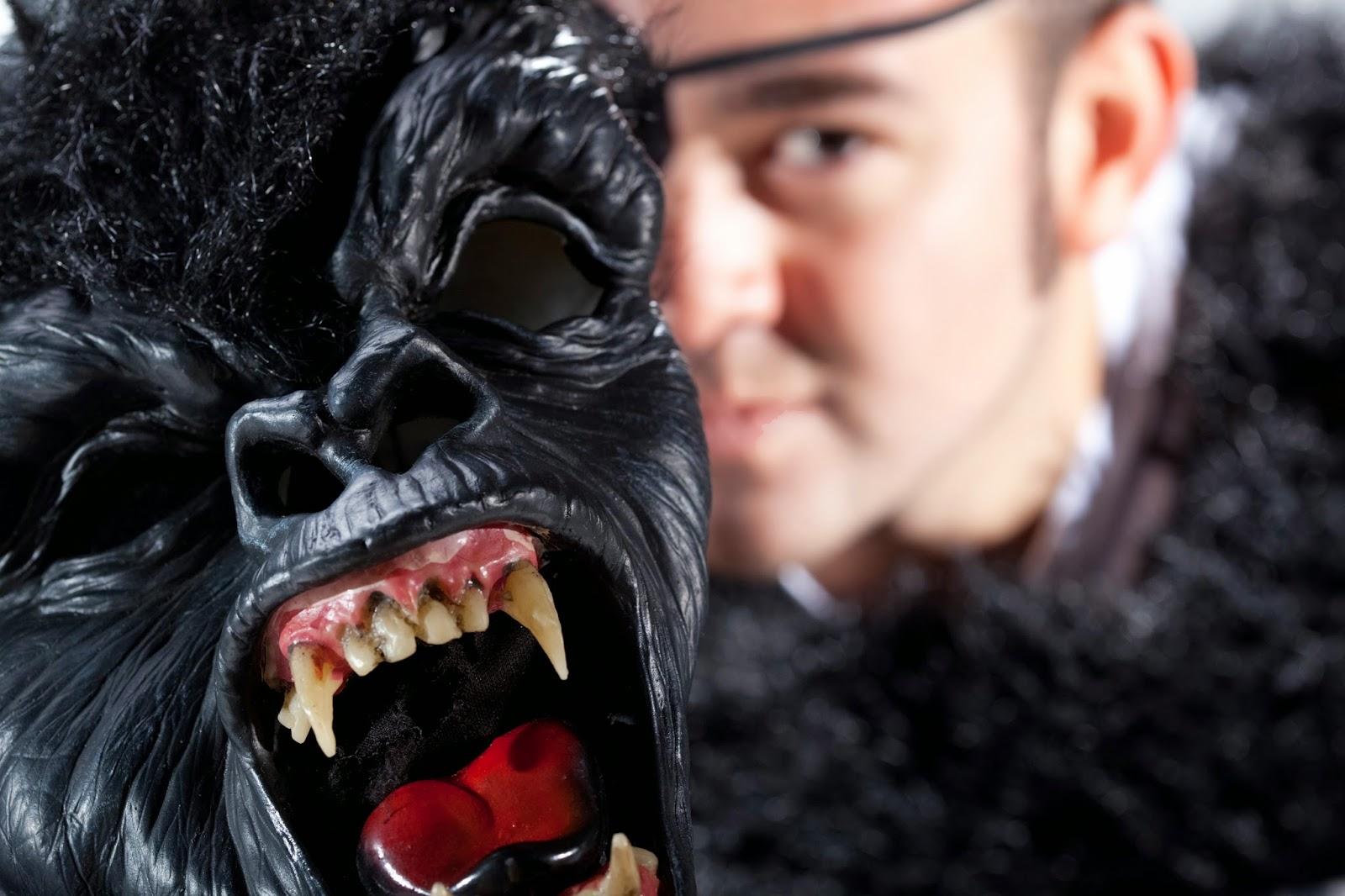 Man holding gorilla mask