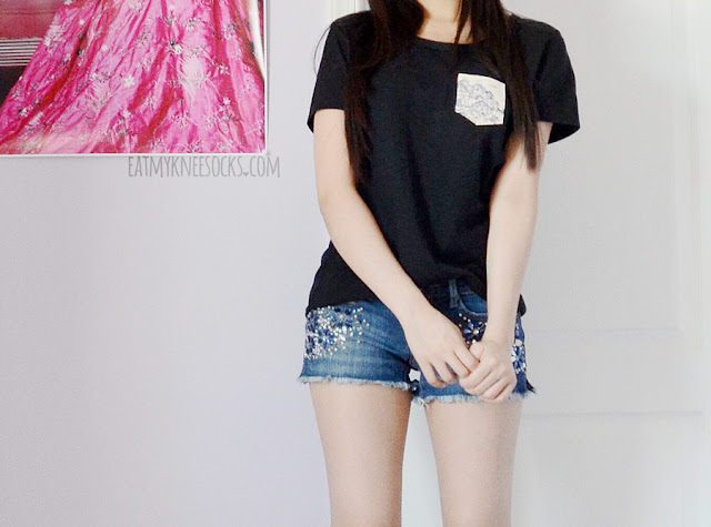 A casual, simple outfit featuring the Japanese Village pocket tee from Tea Apparel and rhinestone-embellished Abercrombie denim shorts.