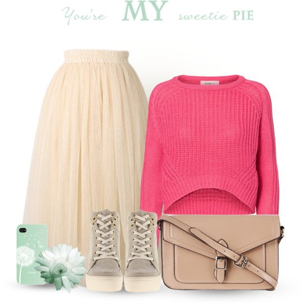 Sporty chic: tulle skirt, crop jumper, trainers and satchel. Visit www.forarealwoman.com  #fashion #blogger