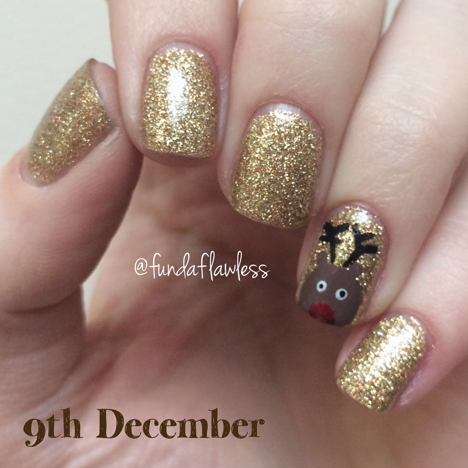 Gold Glitter and Reindeer Nail Art