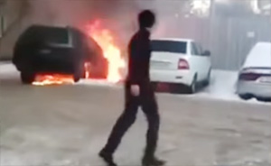 Hapless driver's desperate bid to save his car from fire ends in disaster