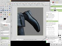 agar seleksi yang terhapus menjadi transparan pada GIMP