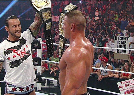 جون سينا يستعيد لقب البطولة من مستريو وسي ام بانك يفسد فرحته cena punk.jpg