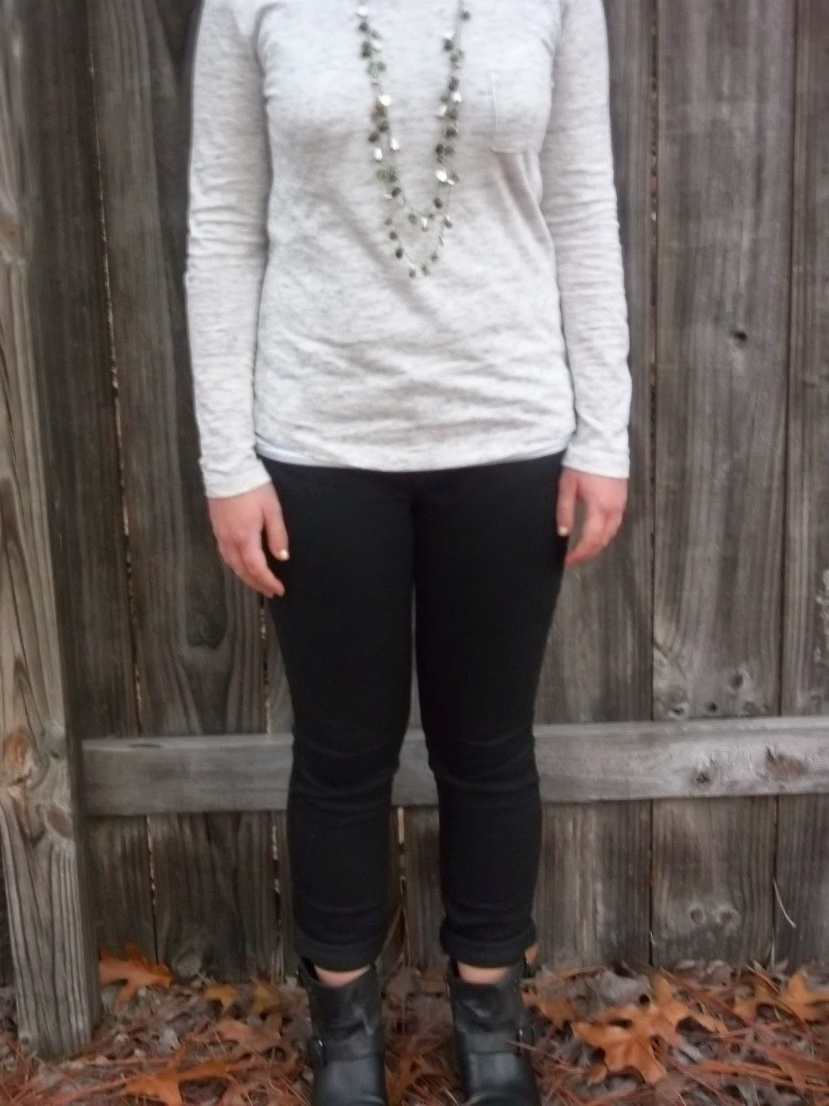 Edgy Cute. Pocket tee, black jeans, black ankle boots, green necklace, yellow purse