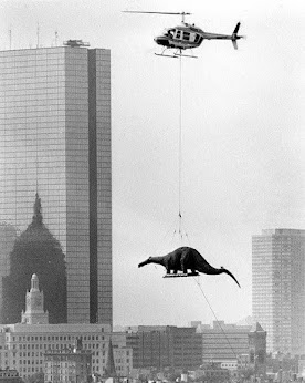 A dinosaur model being delivered to the Boston Museum of Science, 1984