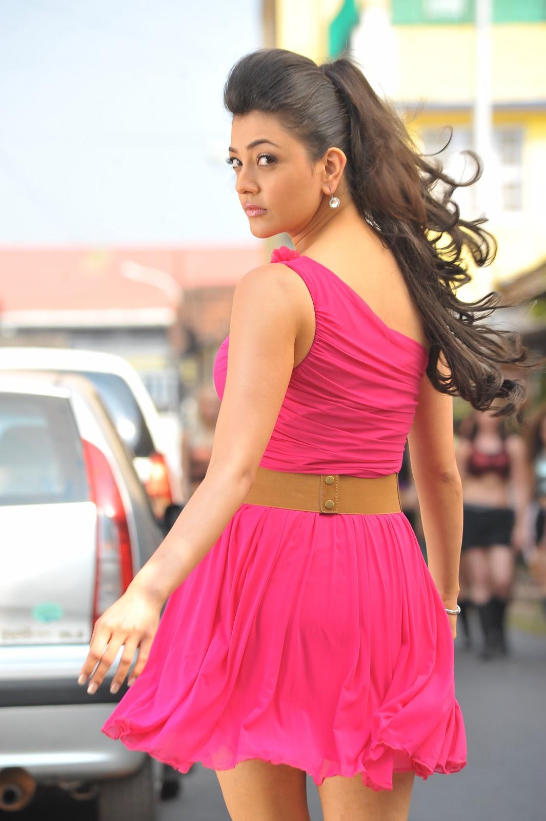 Kajal Agarwal in Pink Short Skirt in Businessman Movie Photoshoot
