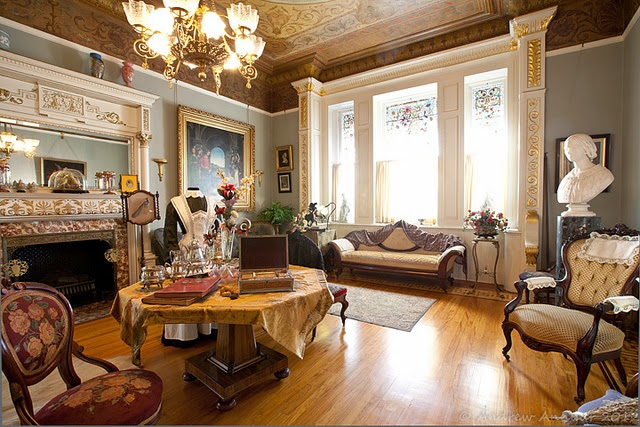 Image of ornate sitting room. Various patterns and colours in room.