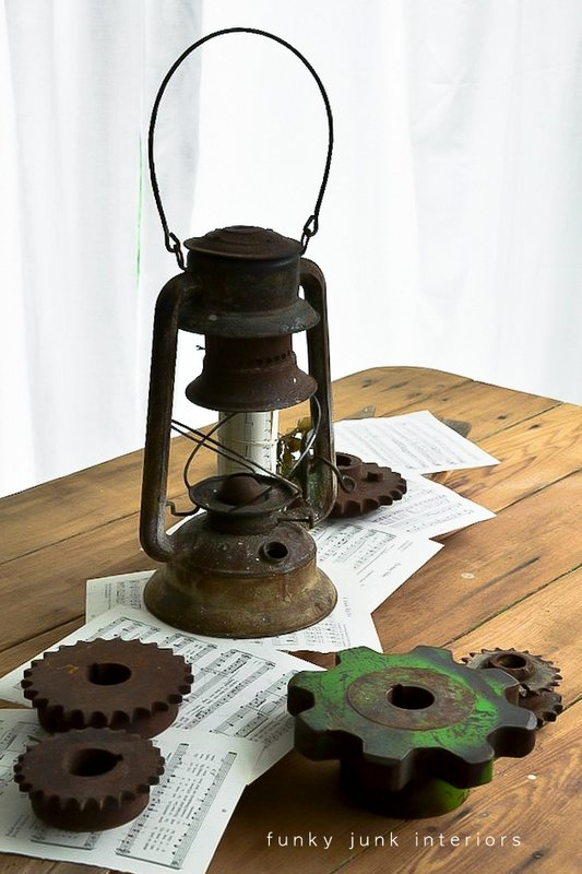 rusty gears, lantern and sheet music