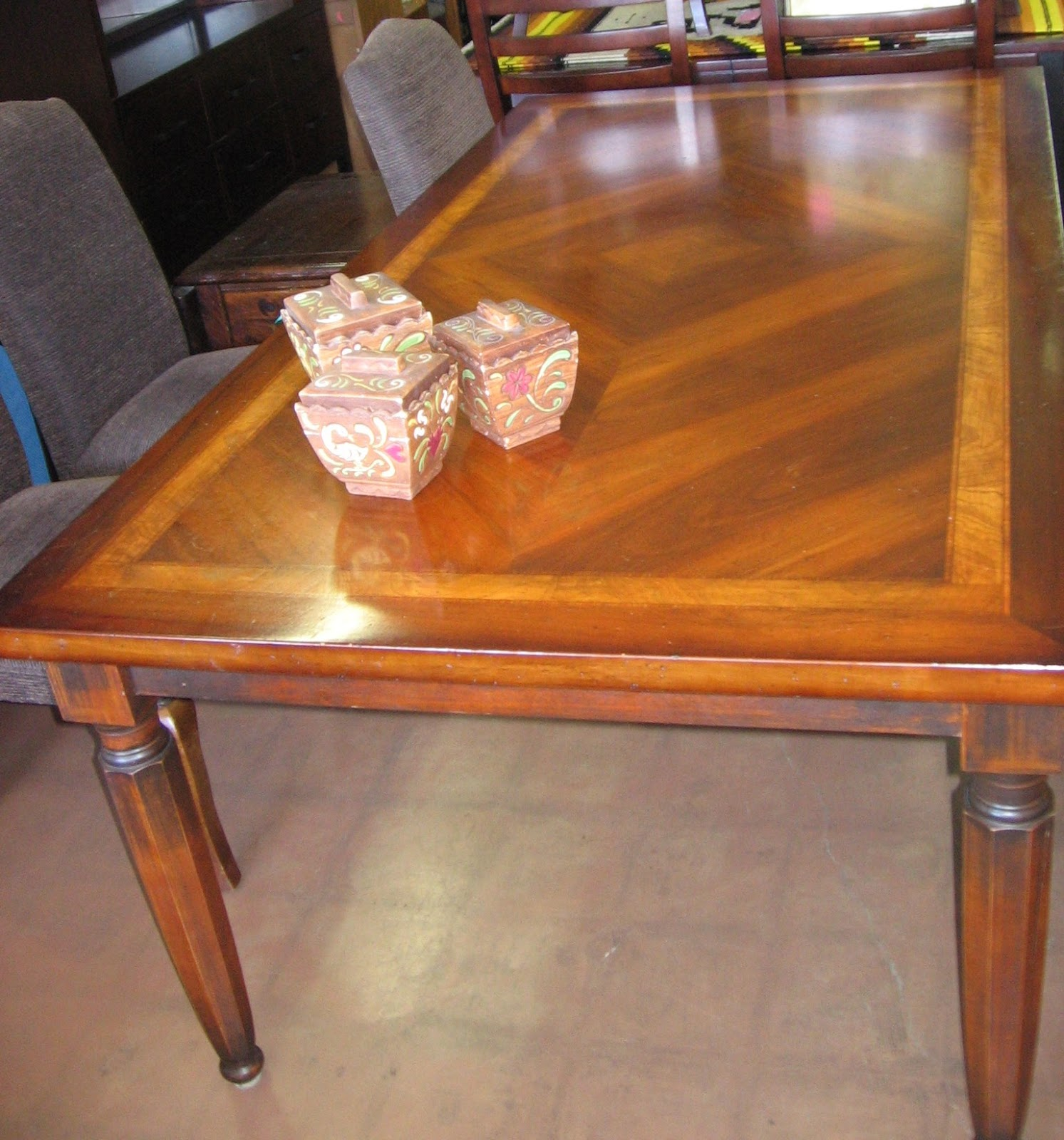 Big and beautiful! This warm and glowing wooden dining table was made  title=