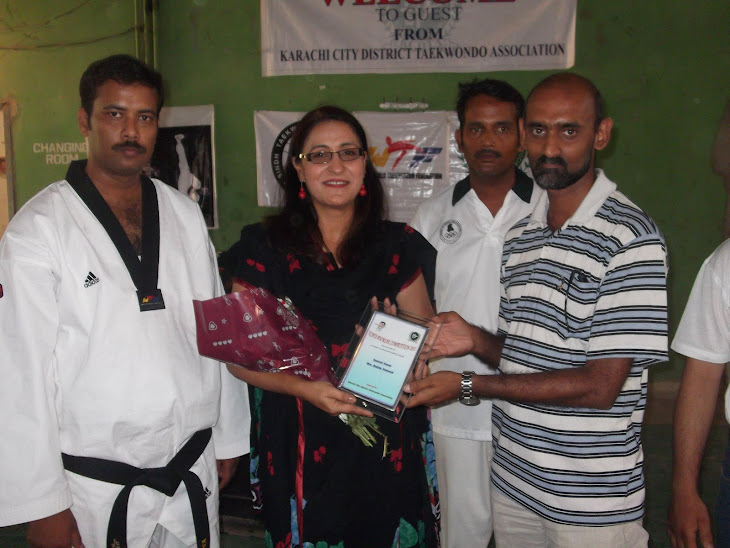 PRESENTED TO SHIELD , CH. GUEST MADAM MAJIDA HAMEED