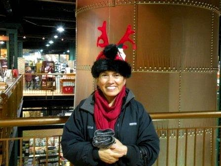 A woman wearing a reindeer hat
