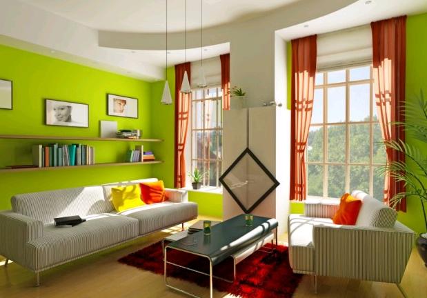 Il verde delle pareti e il rosso dei complementi rendono giovanili e freschi gli ambienti della casa