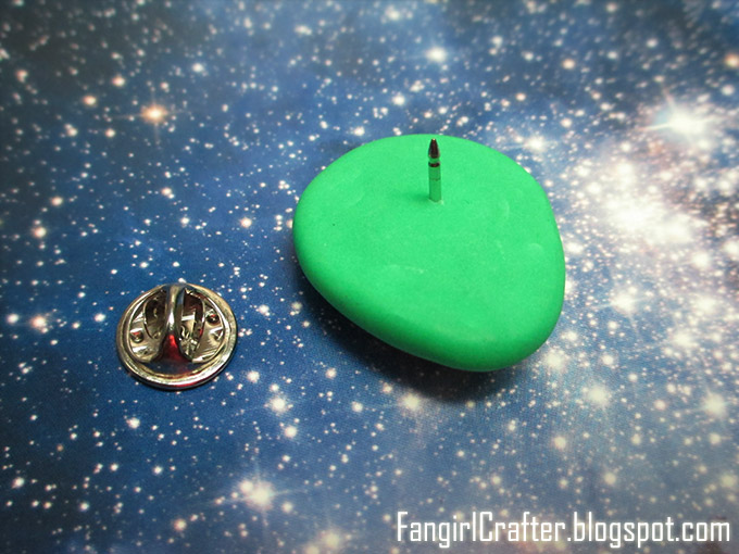 Polymer clay alien head pin back