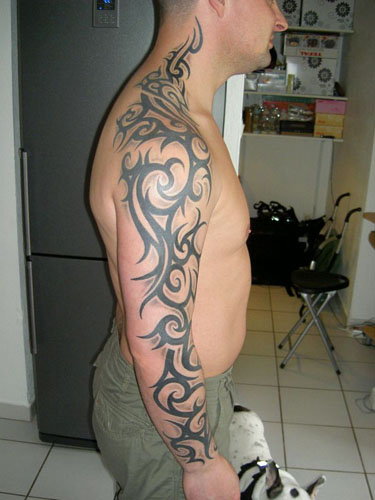 Zombie designstattoo tribal tattoo arm sleeve design for Tribal body tattoo