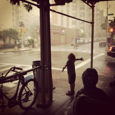 Rainstorm from under scaffolding, Washington Heights, NYC / © 2012 Amber Schley Iragui