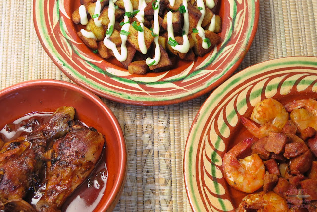 Braised drumsticks, potatoes bravas with aioli, shrimp & sausage