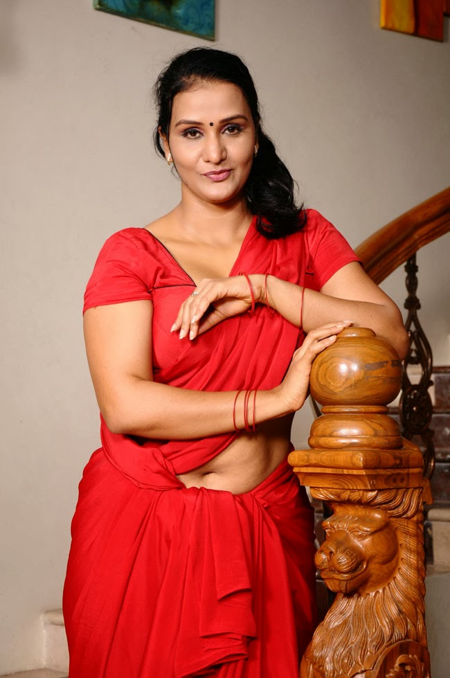 hot sizzling Apoorva hot photo gallery in red saree navel show