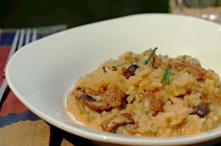 sausage risotto in white bowl