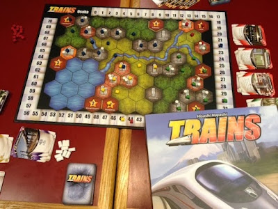 Trains board game in play