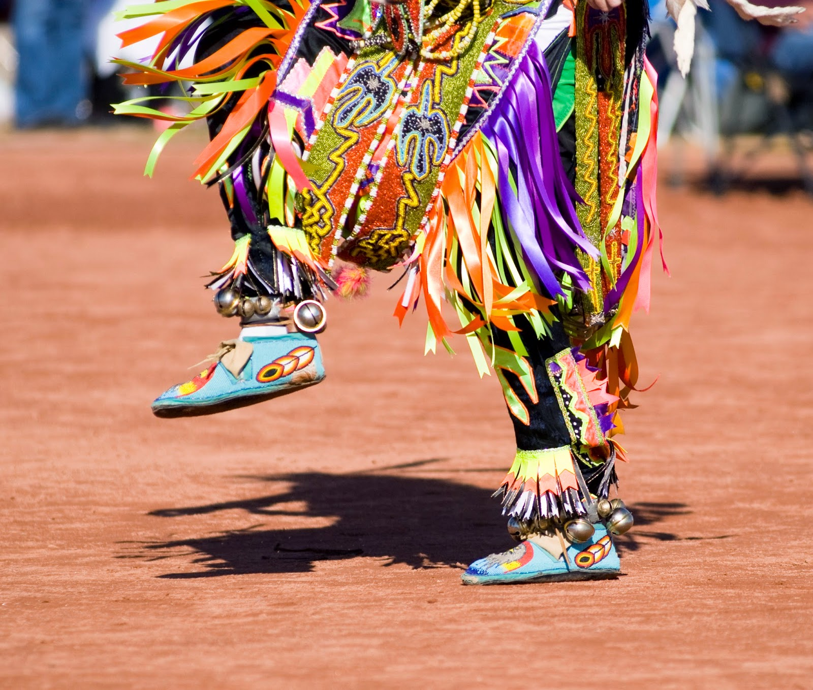 Image of dancer with colorful moccasins and dress