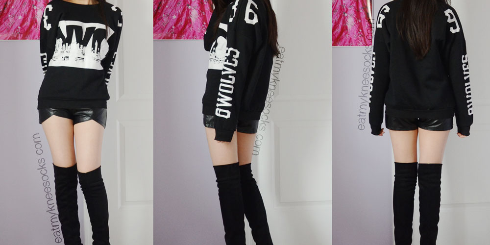 Front, side, and back views of the black NYC sweatshirt from JollyChic, paired with leather shorts and over-the-knee boots.