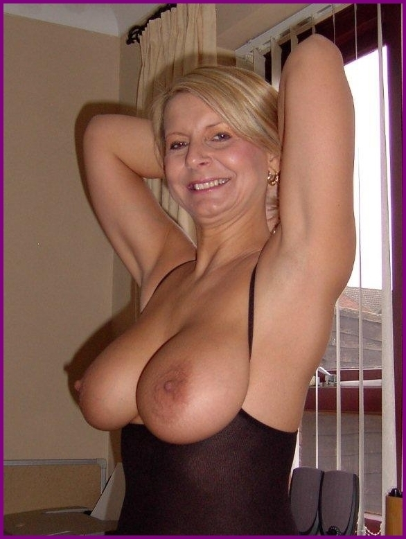 Mature blonde with big boobs