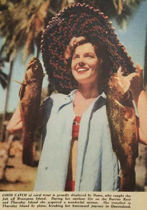 Model Dawn Read with her catch off Brampton island, 1954