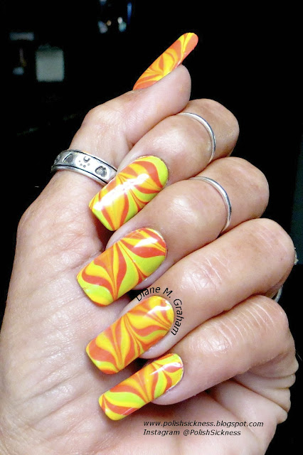 Sally Hansen Mighty Mango, Studio M Neon Caution, Essie The More the Merrier, water marble