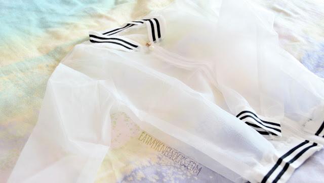 Details on Dresslink's contrast striped-trim sheer organza bomber jacket.