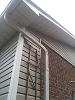 Broken downspout strap