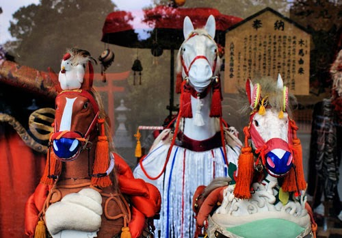 Decorated horses in a shrine