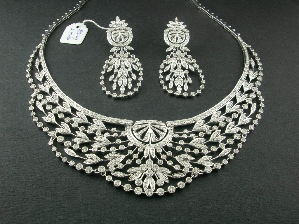 Punjabi suit designs designs of diamond jewellery for Top fashion jewelry designers