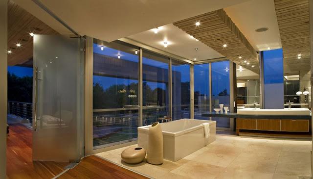 Photo of modern bathroom with minimalist bathtub by the window