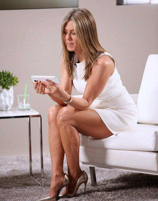 Jennifer Aniston proved how she keeps the glory in her schedule as she looked super beauty in white mini dress at the variety studio on Sunday, November 9, 2014.