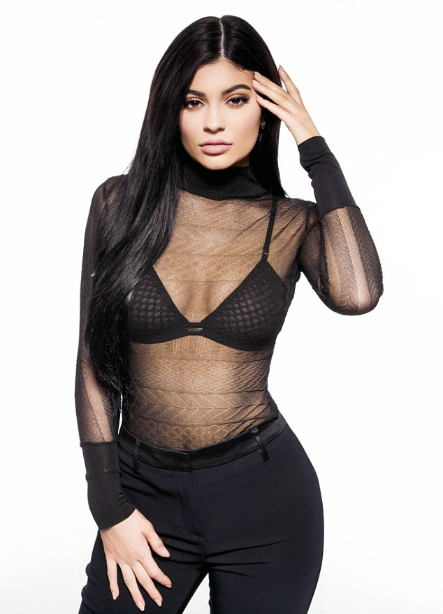 Kylie Jenner looks sensational as she reveals her black bra in a sheer top to celebrate her latest beauty campaign 1