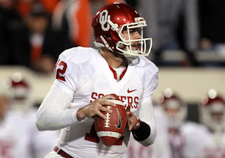 Landry Jones #12 of the Oklahoma Sooners throws against the Oklahoma State Cowboys at Boone Pickens Stadium on December 3, 2011 in Stillwater, Oklahoma. (December 2, 2011 - Source: Ronald Martinez/Getty Images North America)
