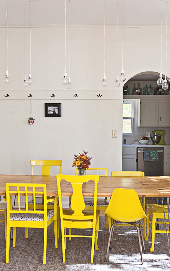Mismatched yellow dining chairs | A Beautiful Mess
