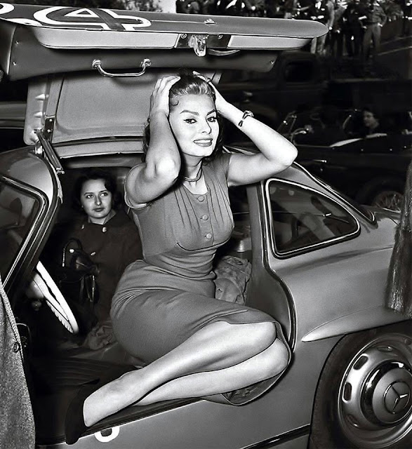 Sophia Loren poses in a Mercedes Benz 300 SL Gullwing in 1956