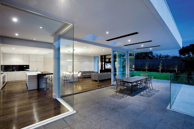 Open glass walls of modern home from the terrace