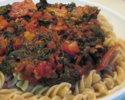 Pasta with chard, tomatoes and bacon