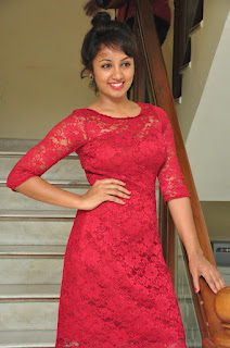 Tejaswo Madivada in loely Gorgeous Transparent Net Full Length Red Gown at Kerintha Success Meet