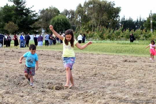 L-R: Tyson Nicoll, Pearl Nicoll, Hastings, playing in the dirt after the official opening and blessing of PNS Pasifika garden, a new section of the community gardens at Te Aranga Marae, Flaxmere, Hastings. photograph