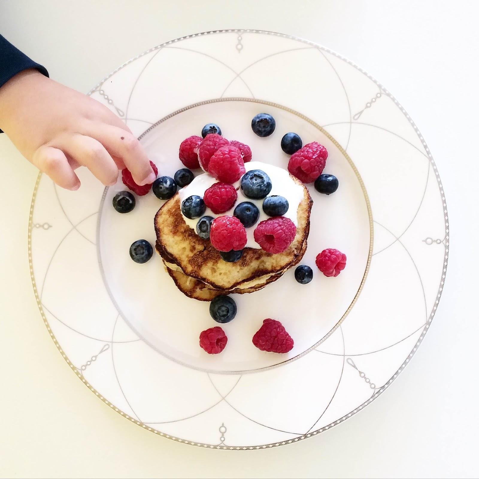 kristjaana mere healthy breakfast banana pancakes raspberries blueberries