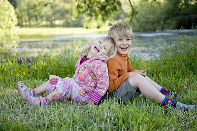 Cute sister brother children Playing outdoors