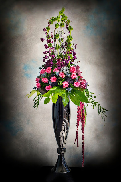 Isha Foss Events roses, dendrobium orchids, thistle, hanging amaranthus, bells of ireland, wire mesh balls