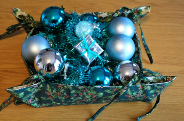 Christmas gift basket filled with tinsel and baubels